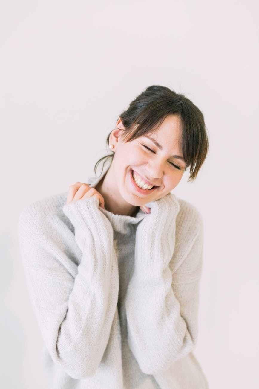 woman wearing white turtle neck sweater