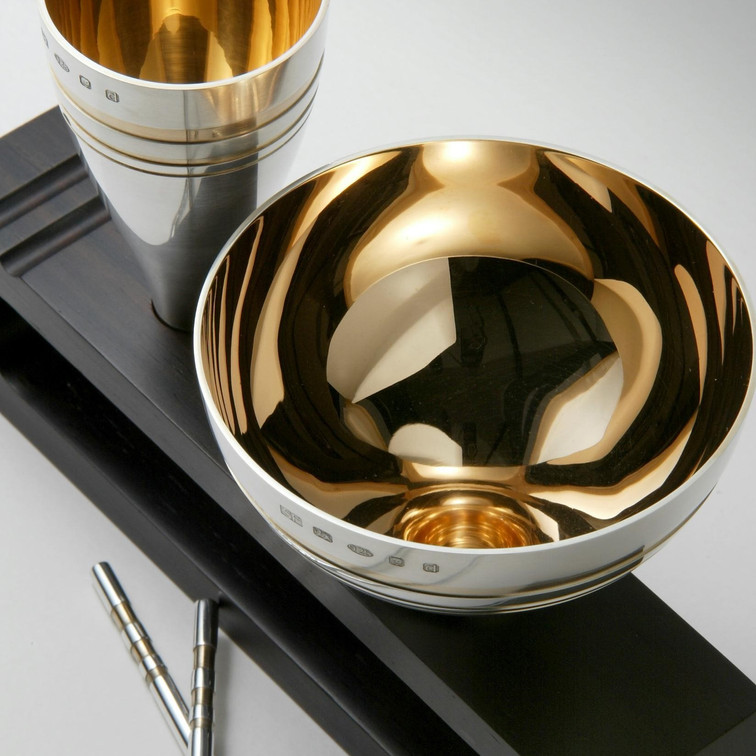 Rose gold plated silver bowls and chopsticks on a violet rosewood stand