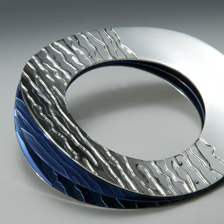 Etched silver and titanium bangle