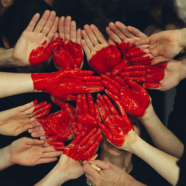 Hands with a red painted heart