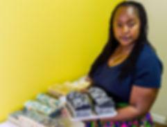 Marcia Allen owner of HiRuna Island Soaps holding handmade natural vegan soap
