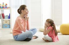 Cute little girl at speech therapist off