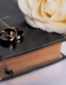 bible with wedding bands