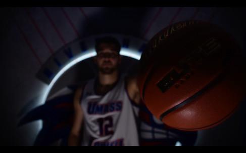 Basketball player palming ball