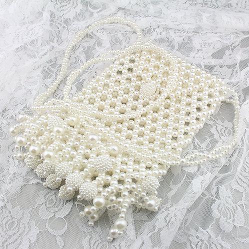 Perle taske med ekstra perler på bunden