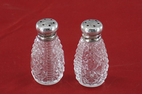 Pair of Salt And Pepper Shakers With Sterling Silver Tops