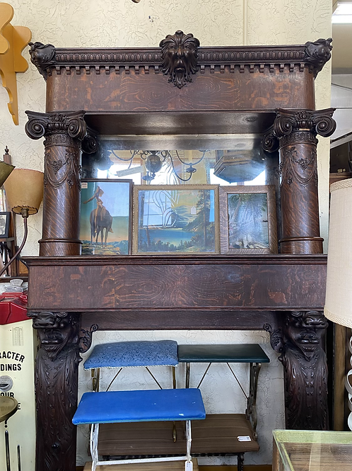 Intricately Carved Quartersawn Oak Mantle with Northwind Face and Lion  CA 1900s