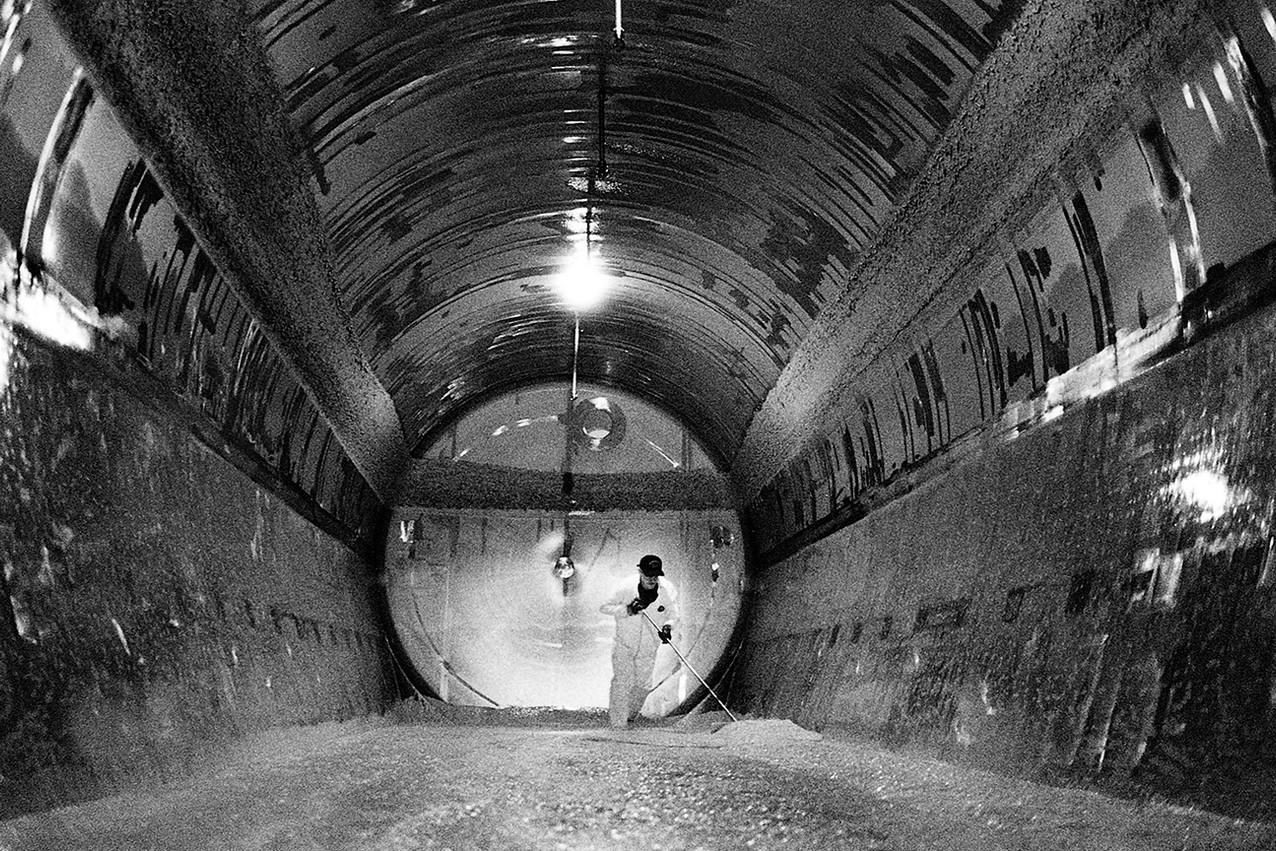 brewery worker removing yeast inside fermentation tank barrie