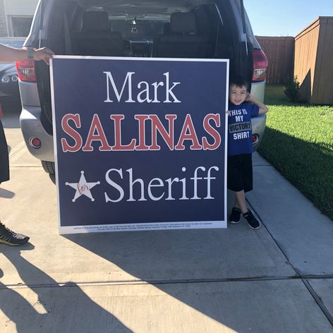 Putting out signs around Galveston County