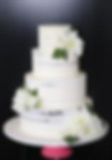 4 tier seminaked wedding cake.png