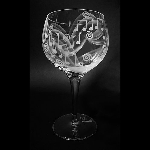 Musical Notes Etched on a Crystal Red Wine Goblet