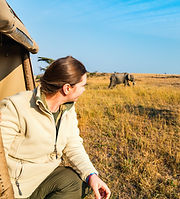 Woman on safari game drive enjoying clos