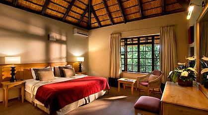 Kruger Park Lodge Chalet Bedroom.jpg