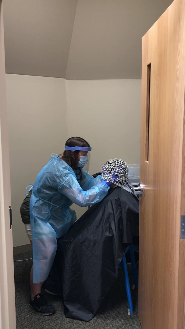 EEG Net being placed with new protective equiptment