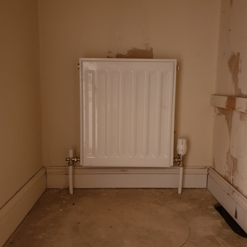 Removing a hot water cylinder in airing cupboard