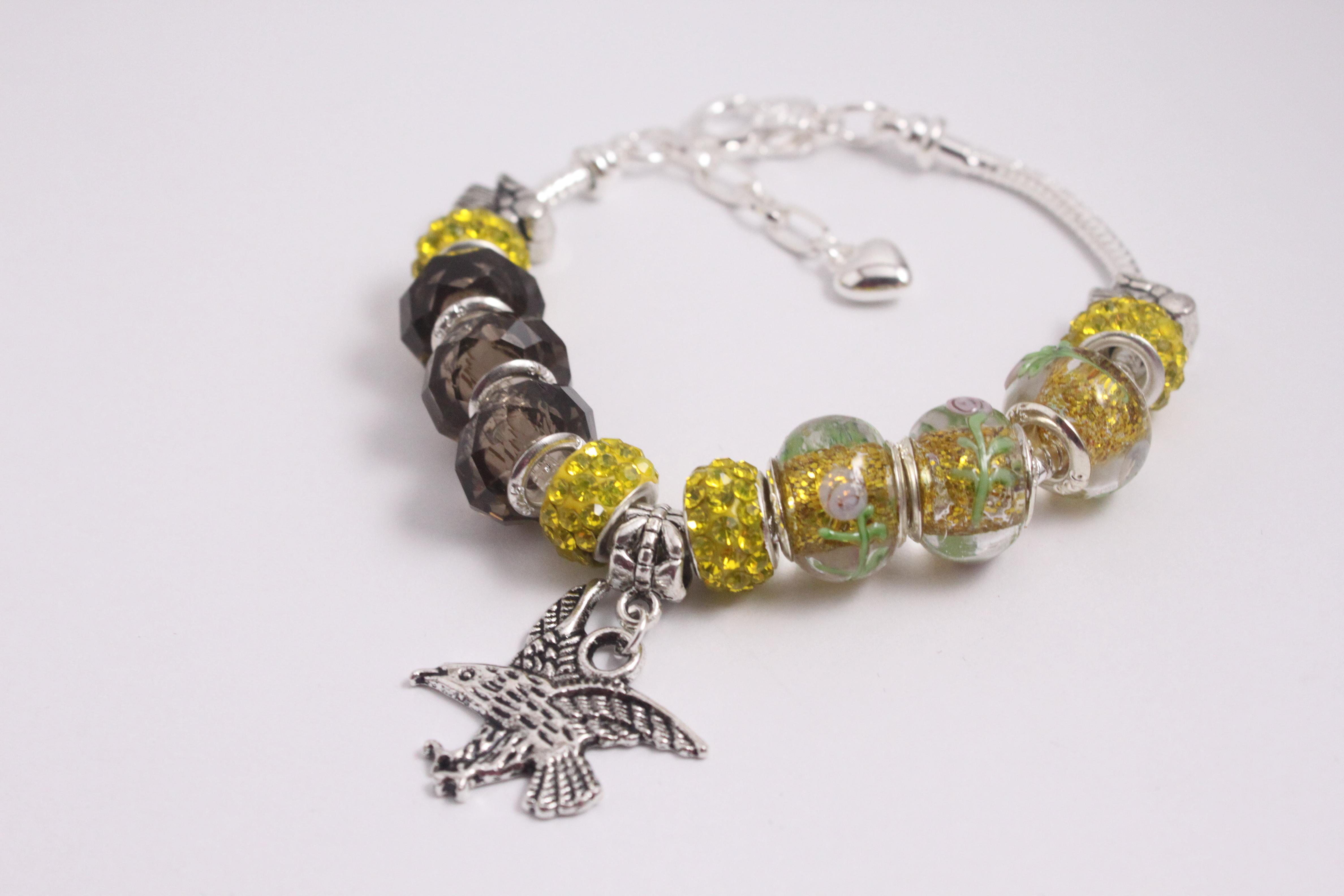 Bird charm bracelet - yellow