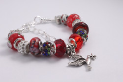 Bird charm bracelet - deep red