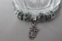 Owl charm bracelet blue white gold
