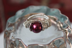 All coiled up ring with purple pearl