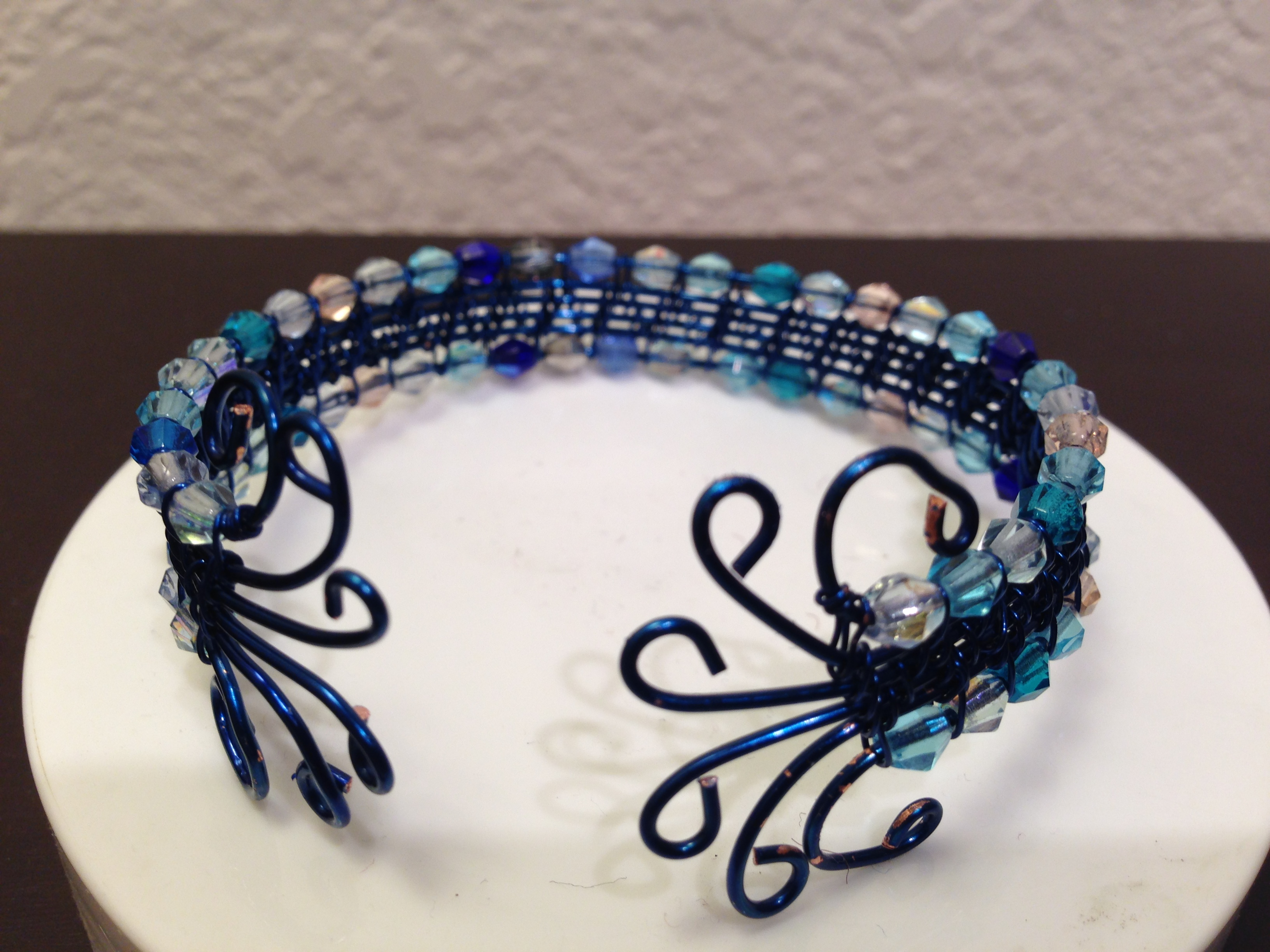 Woven wire bracelet in blue
