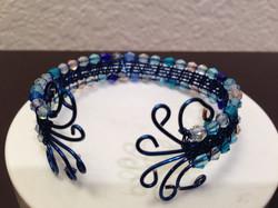 Woven wire bracelet in blue