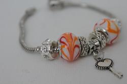 Key charm bracelet orange