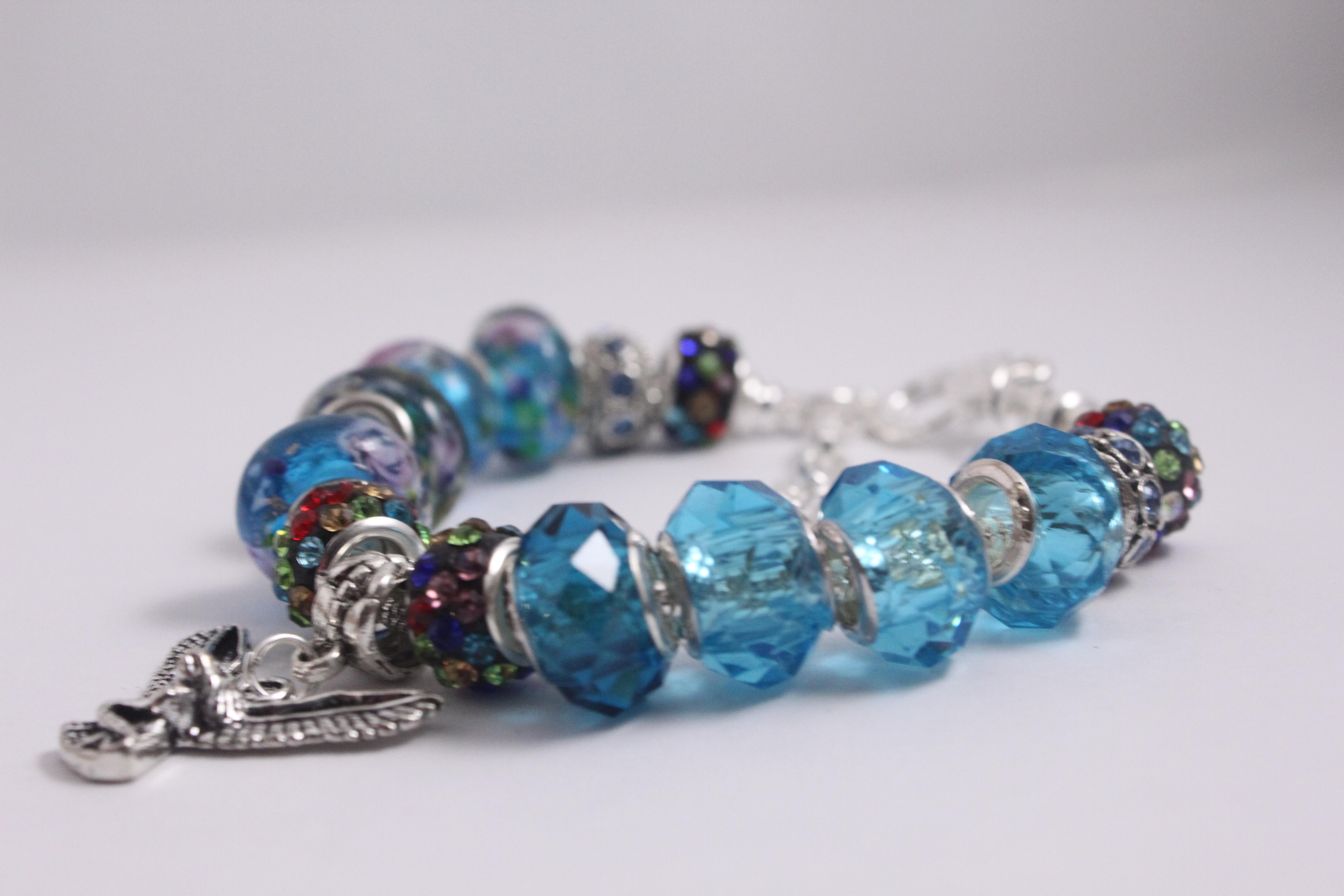 Bird charm bracelet - blue crystal