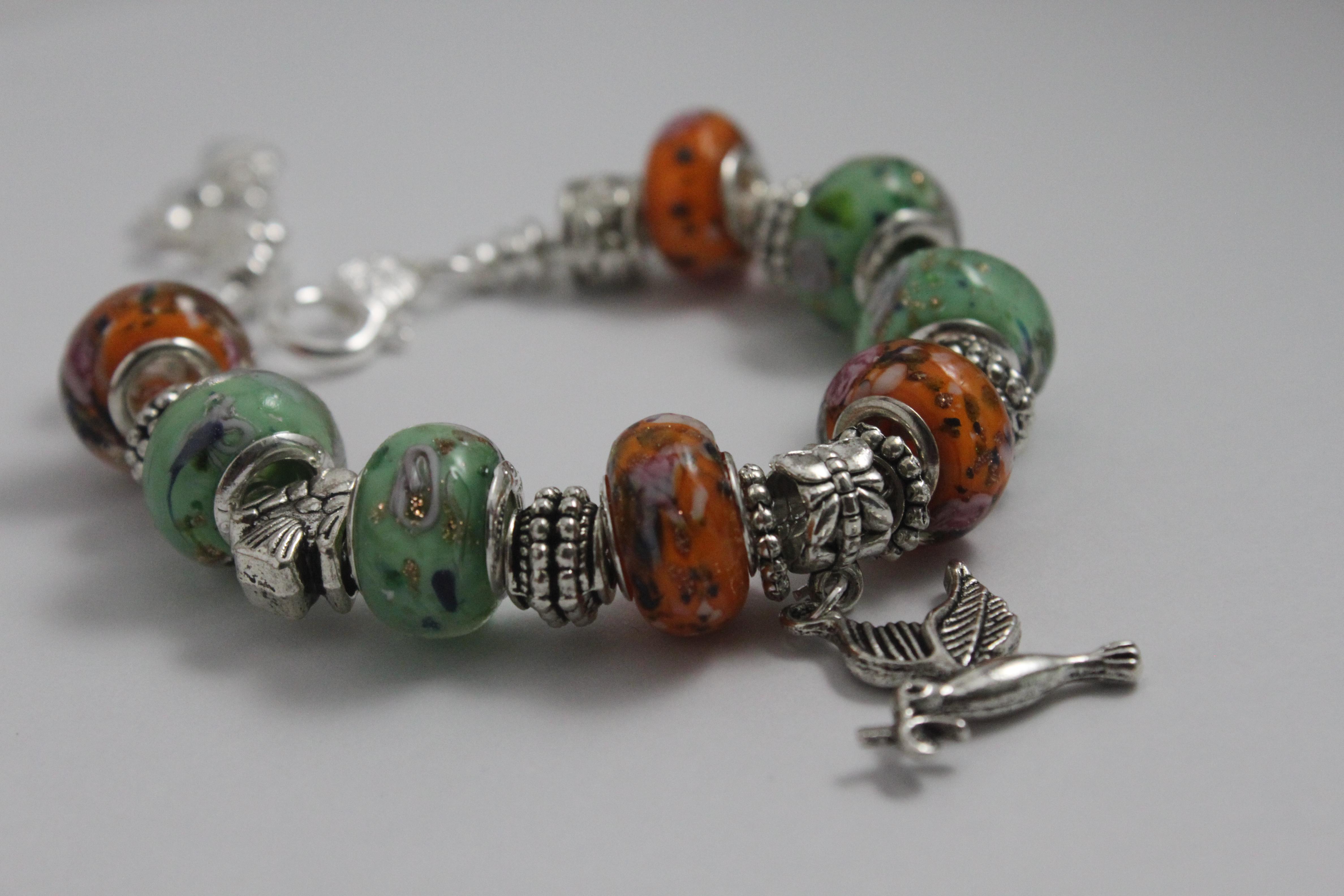 Bird charm bracelet - orange green