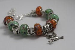 Bird charm bracelet - orange green