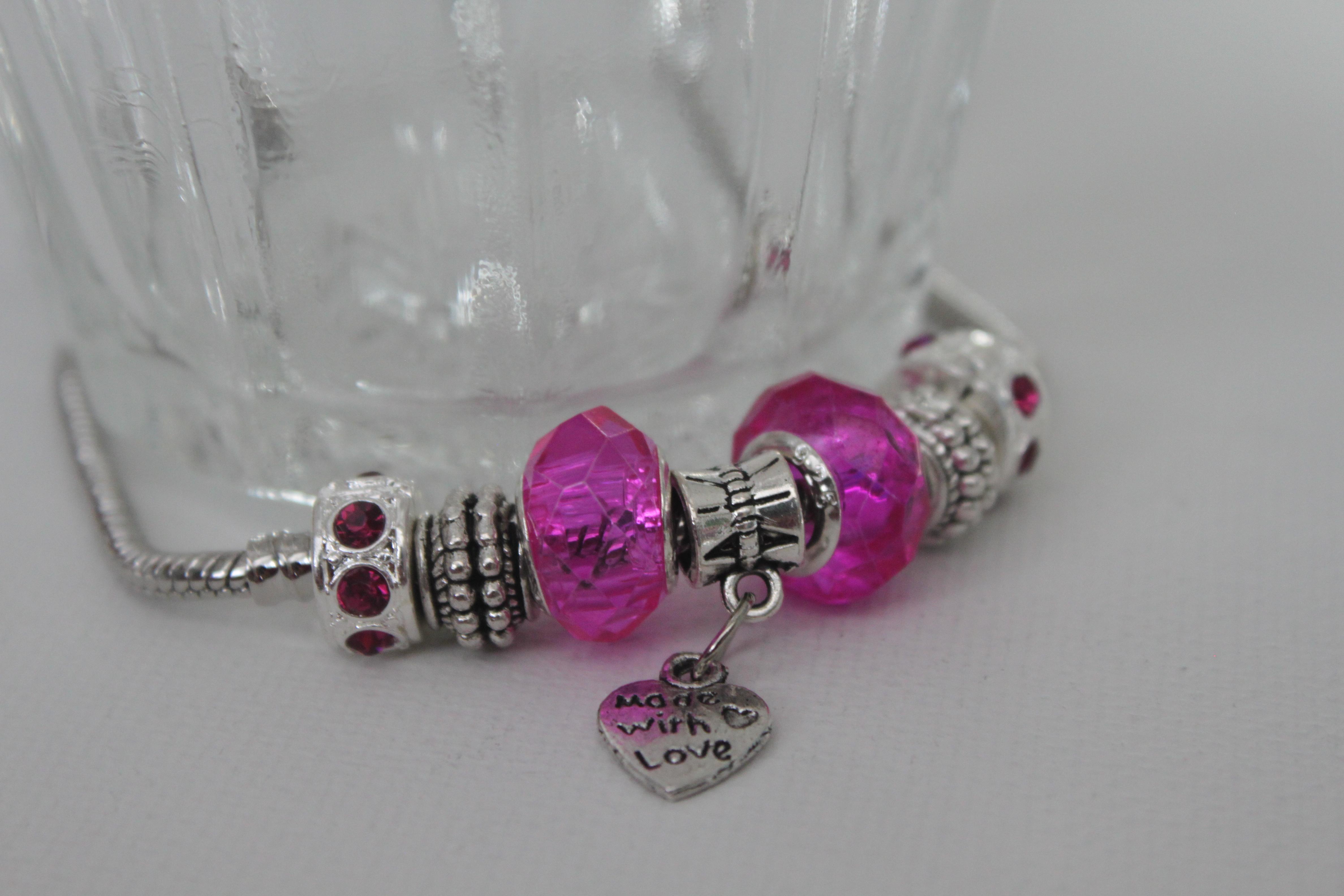 Love charm bracelet in rose tone