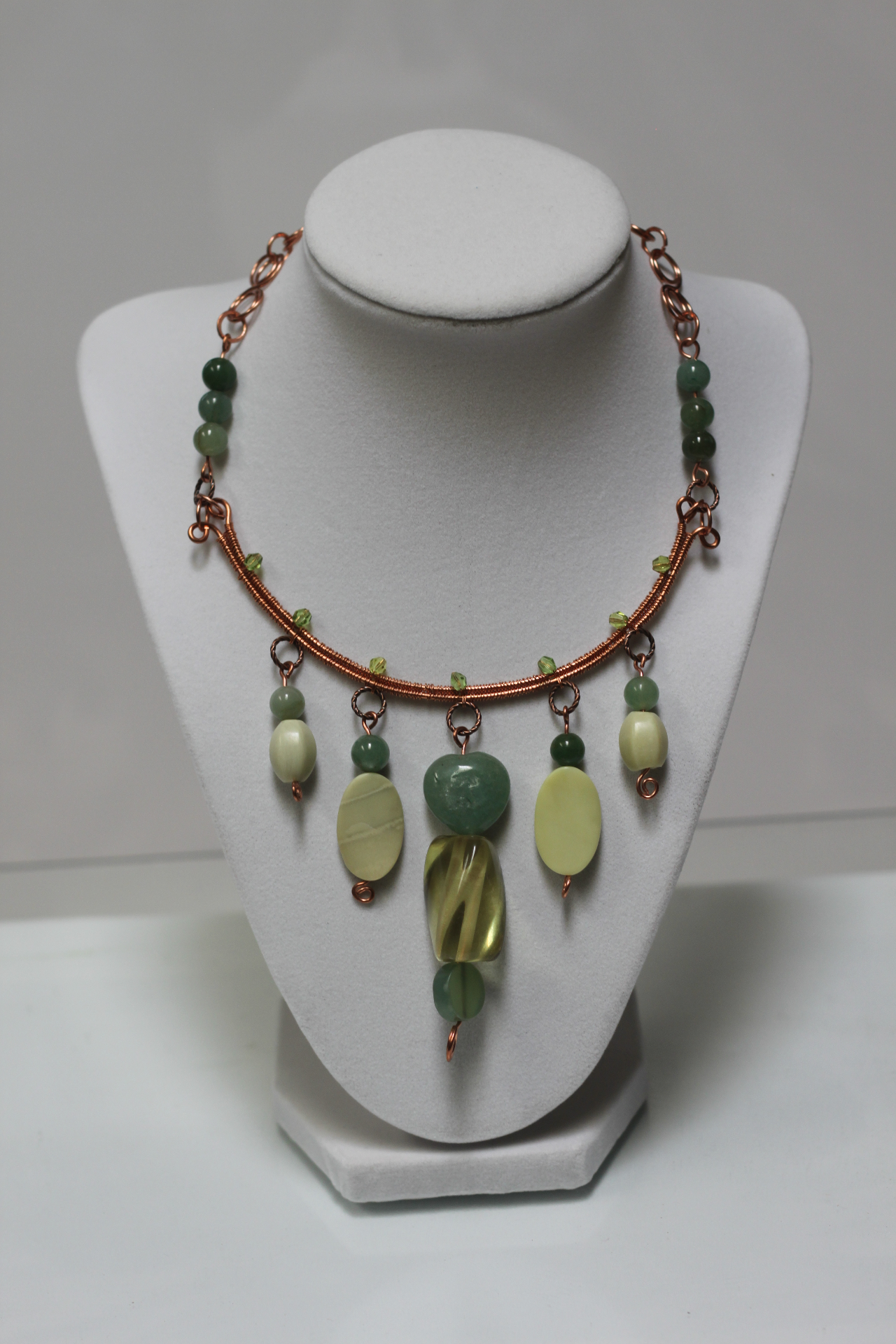Woven necklace with green gemstone