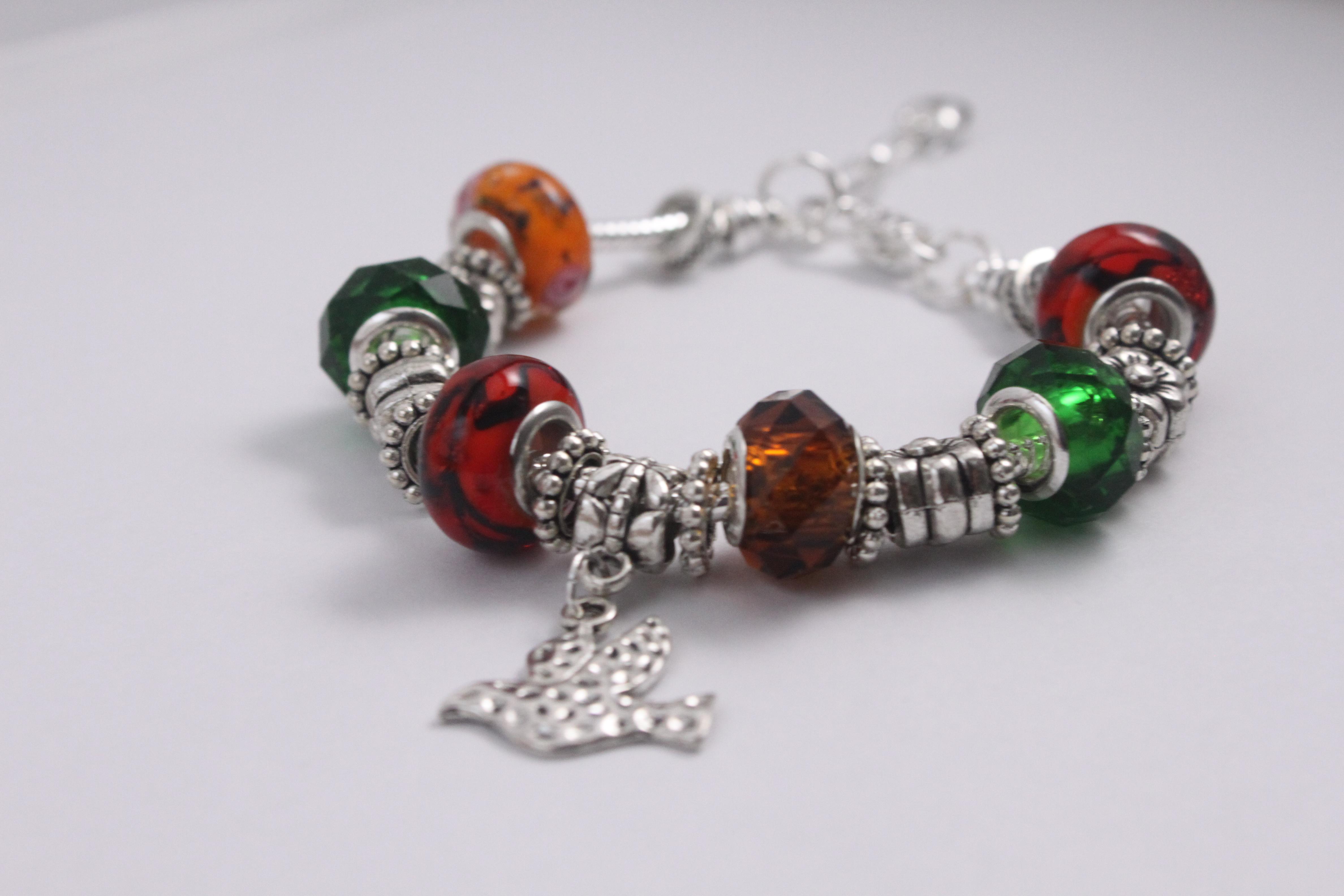 Bird charm bracelet - red green