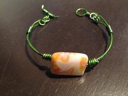 Green wire bracelet with gemstone