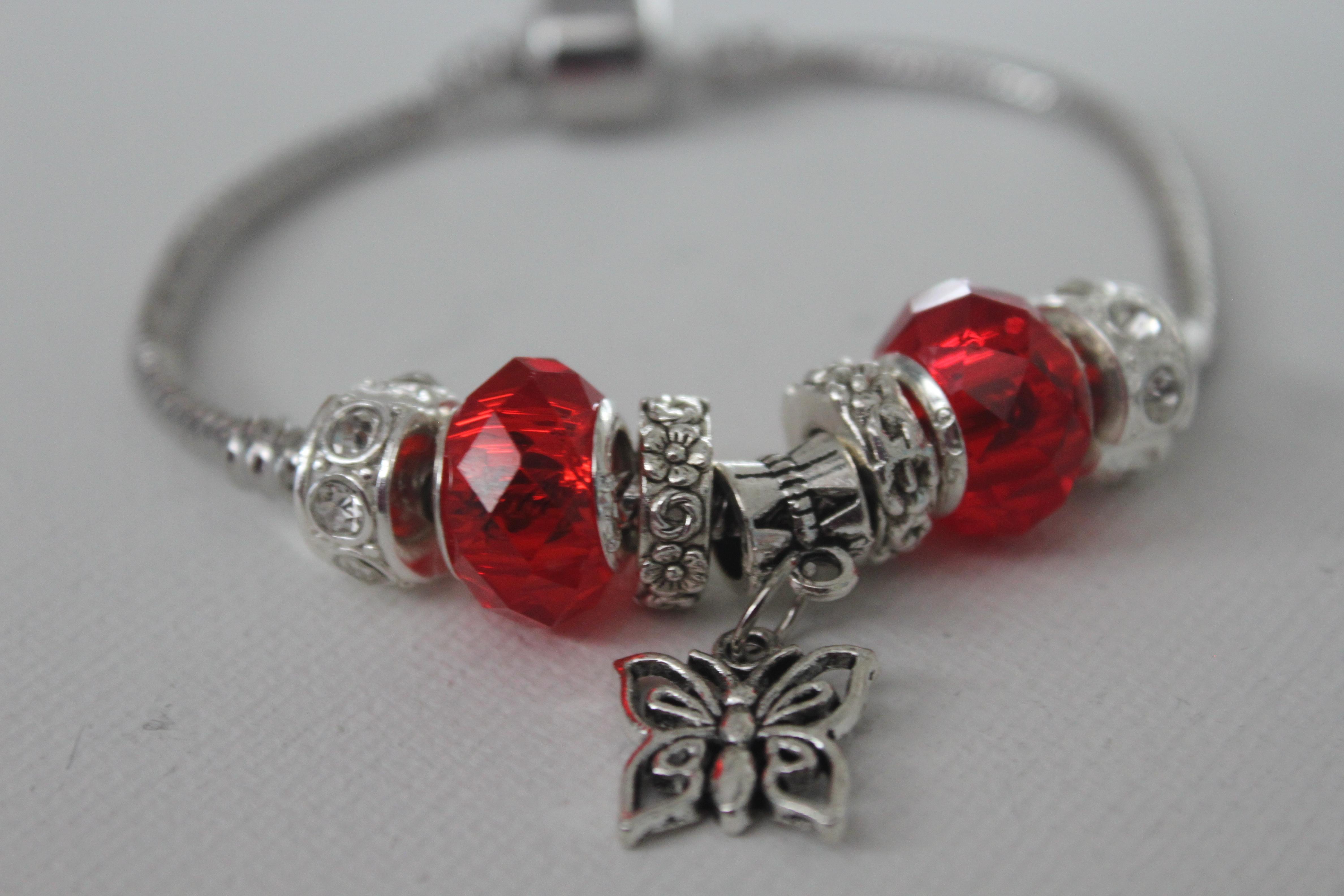 Butterfly charm bracelet in red