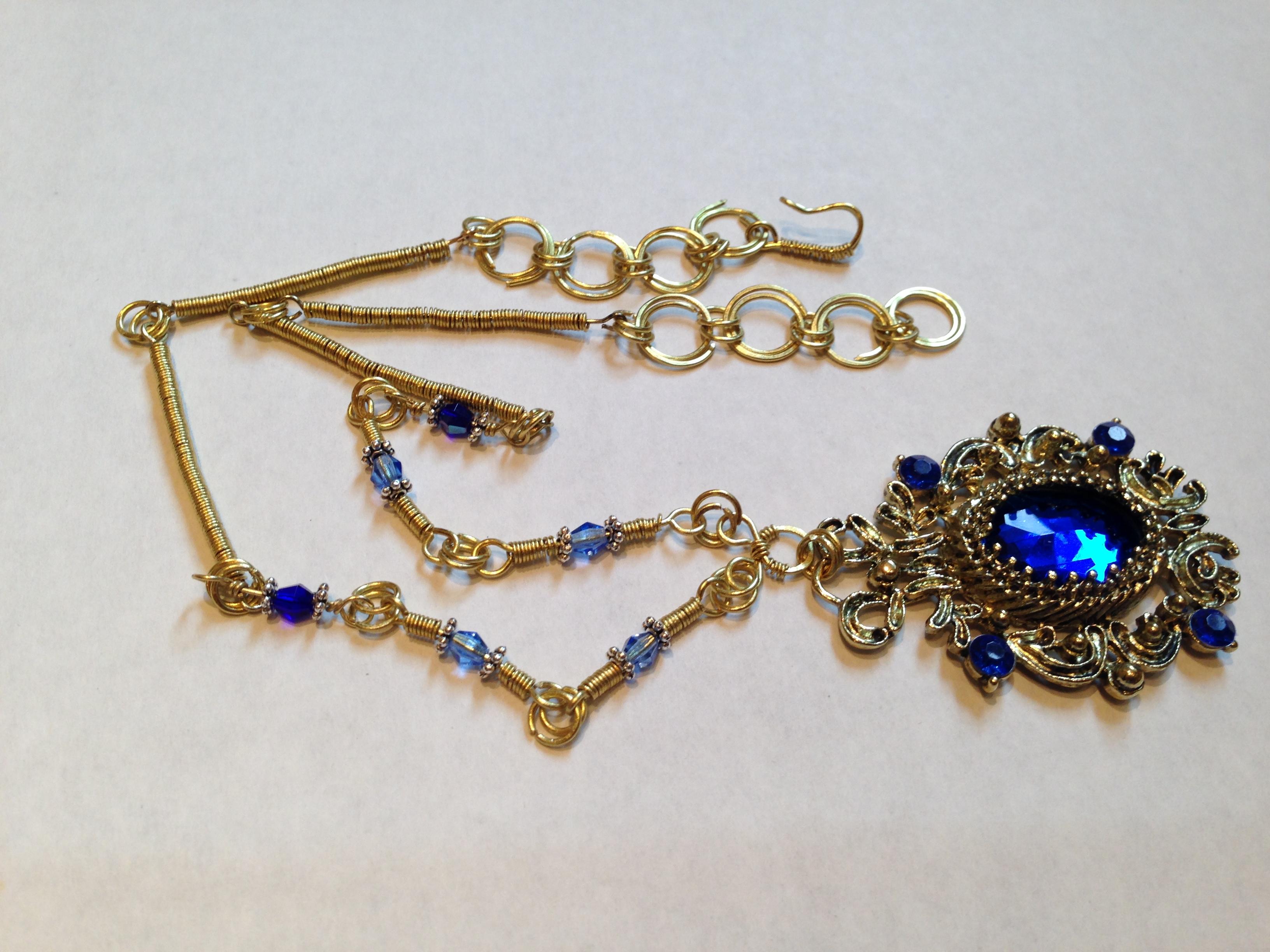 Necklace Blue pendant golden links