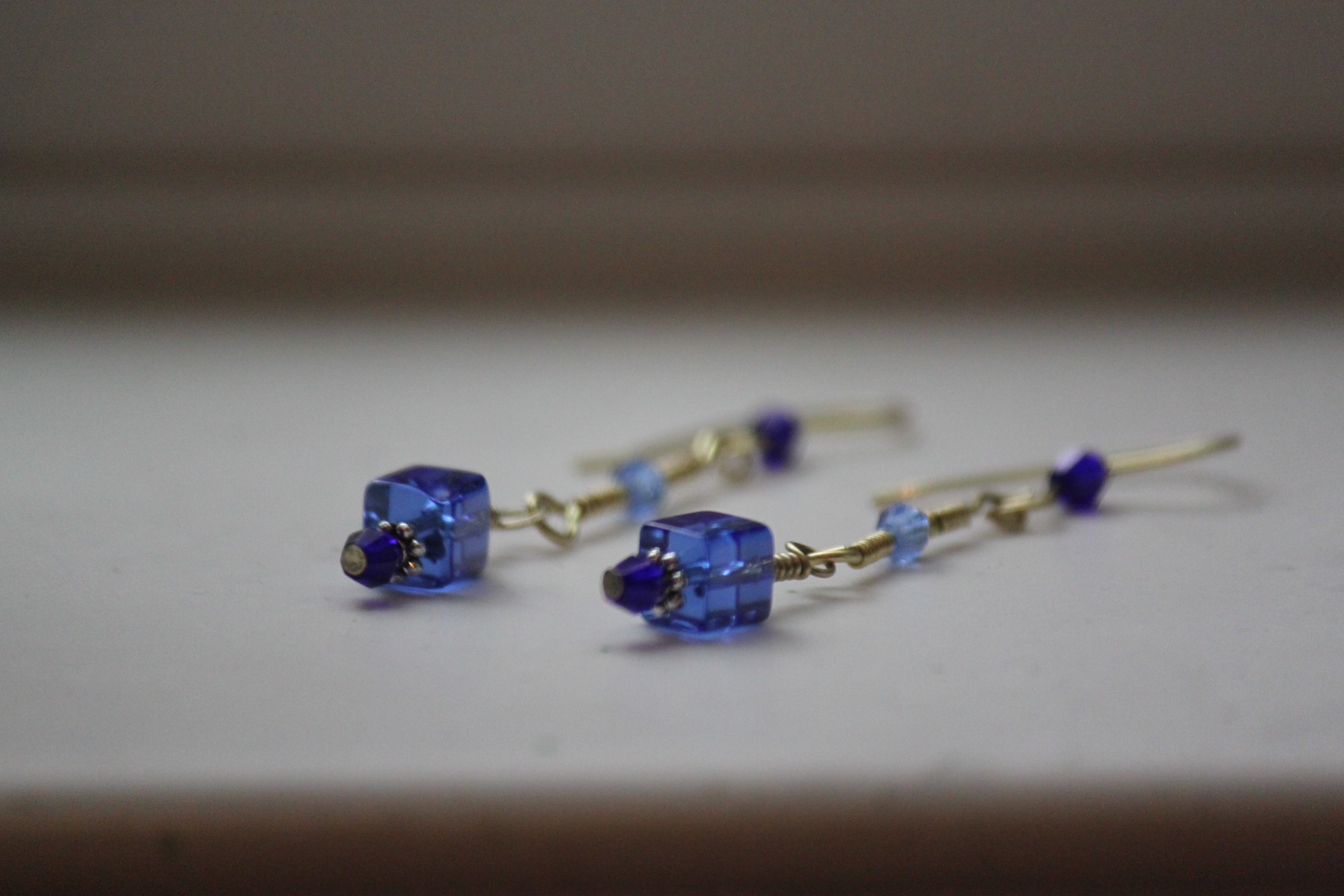 Earrings blue cube beads coiled