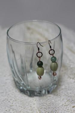 Drop earring with green gemstone