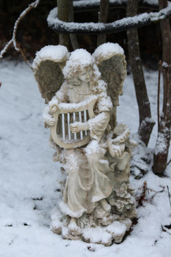 Angel playing harp in snow