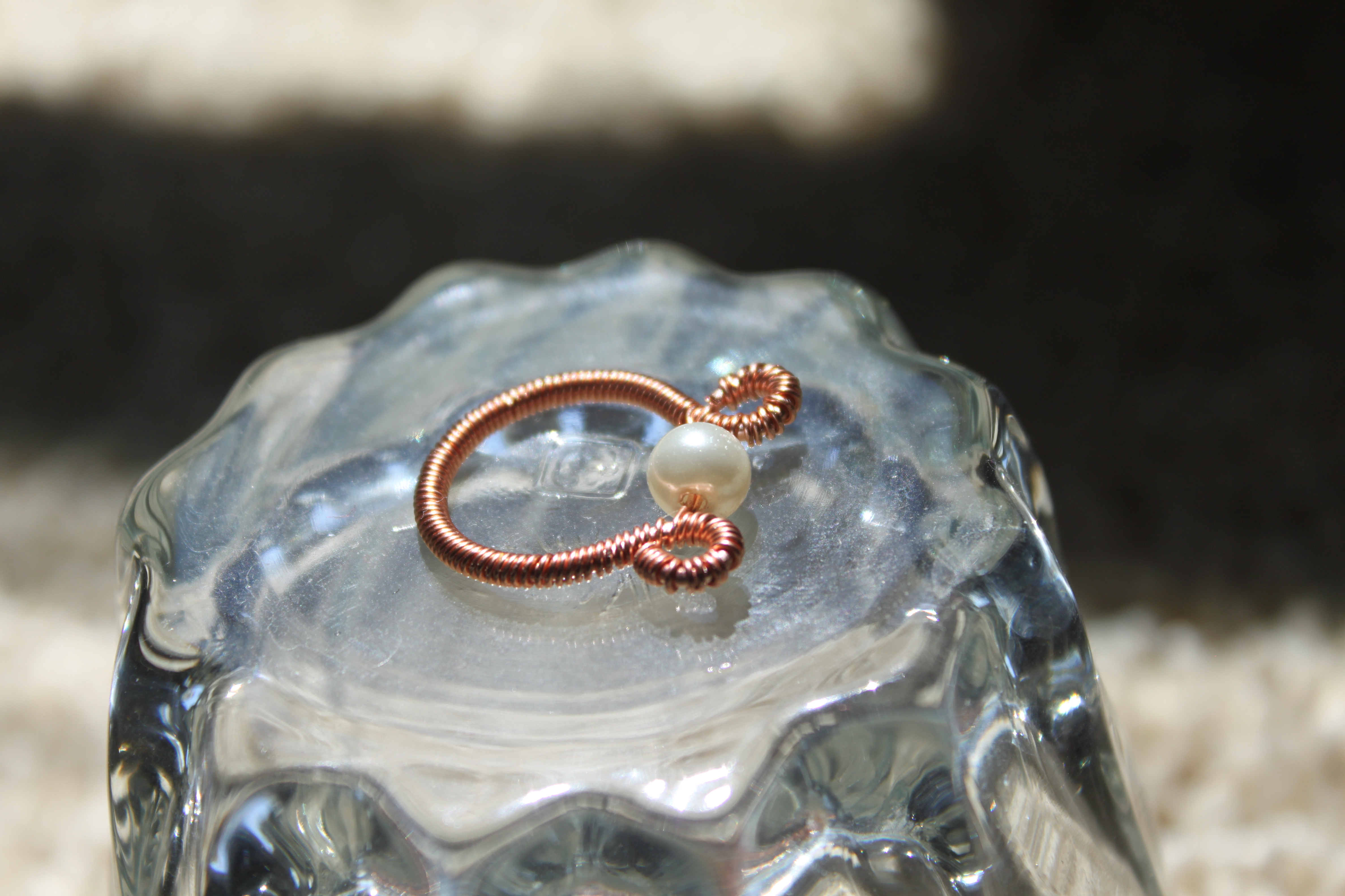 Simple coiled copper ring with pearl