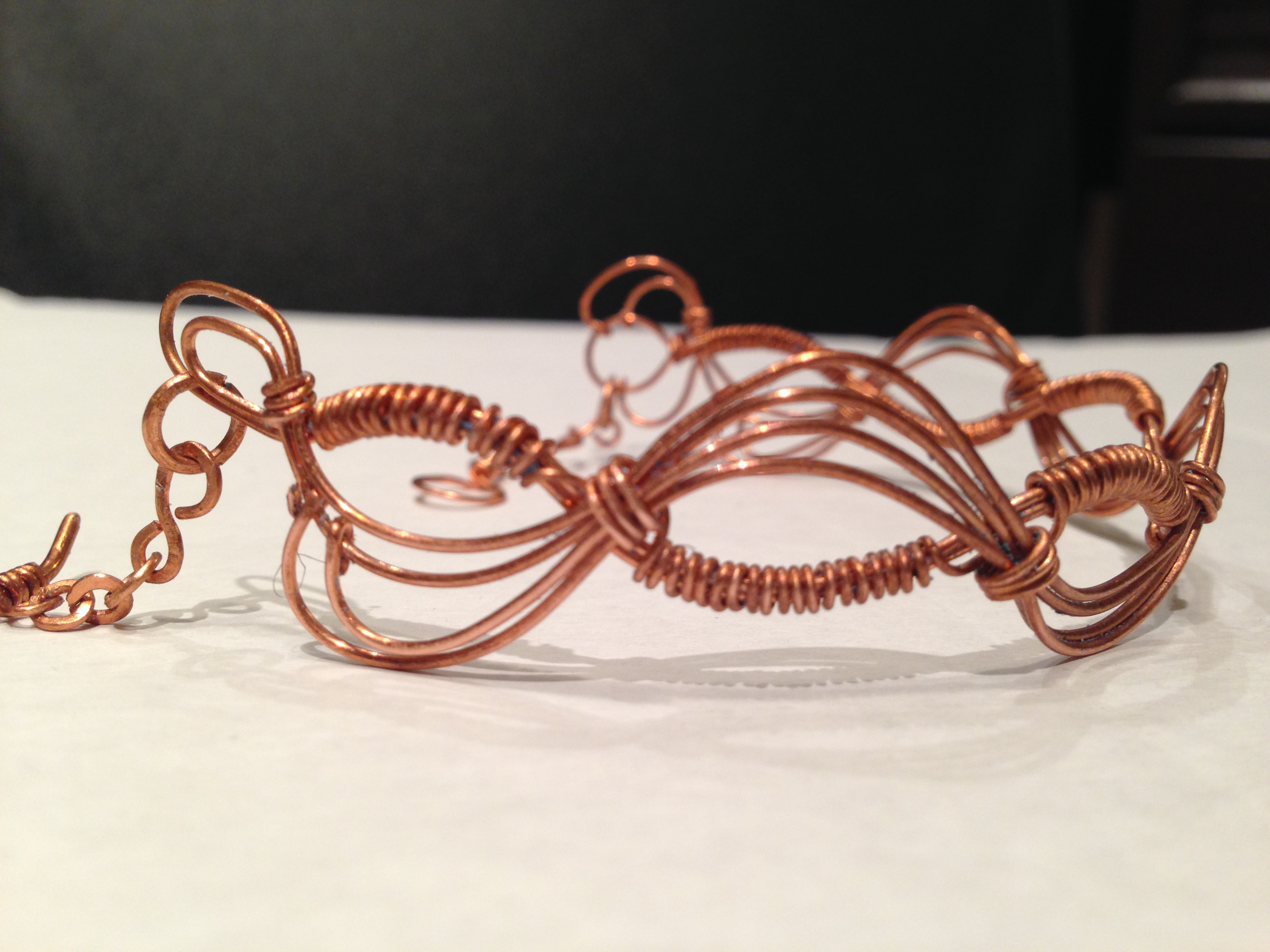Ocean waves shape copper bracelet