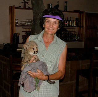 Jane's forced smile with Dottie's rescued cub