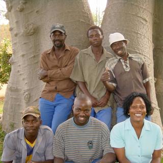 Josef, Frans, Samuel, Johannes, Lucky and Sarah under a baobab