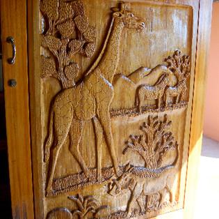 Carved front door of lodge