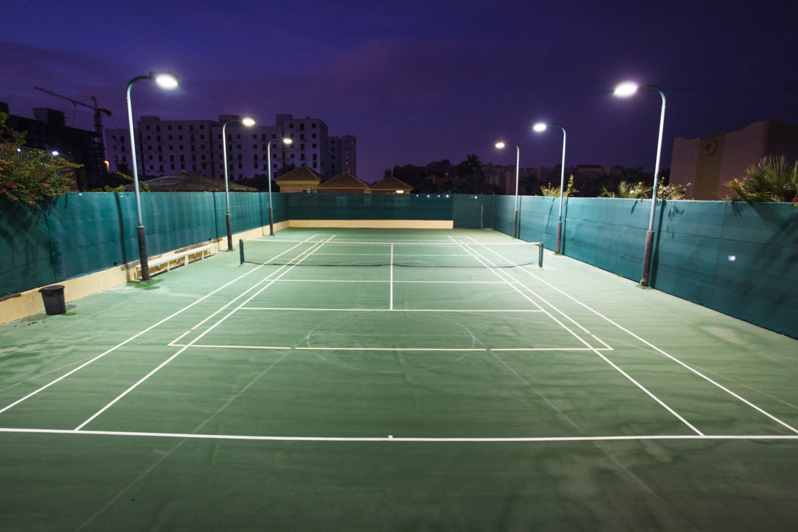 Nighttime photo of tennis court at Las Dunas