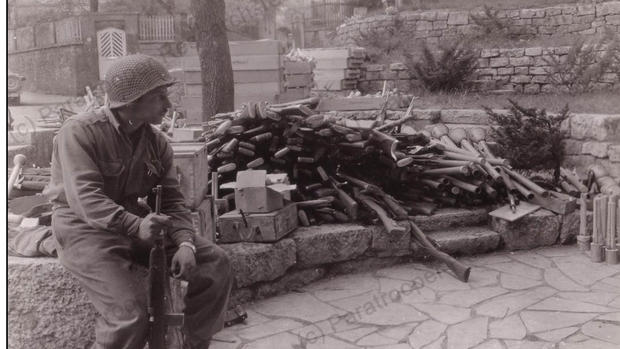 American guarding a pile of captured Ger