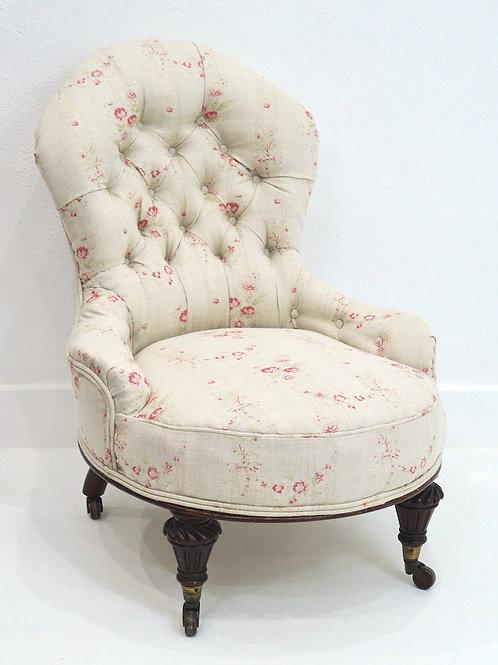 An Antique English Buttoned Nursing Chair