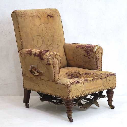 A 19th Century English Upholstered Armchair