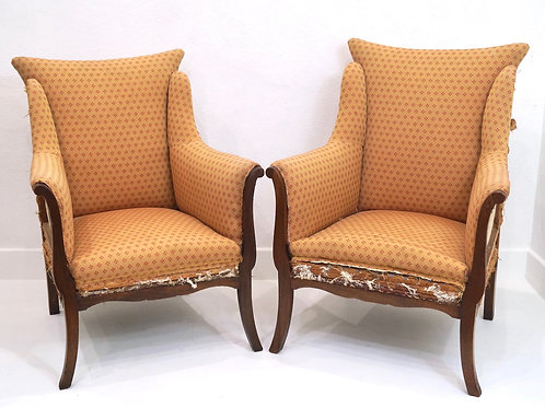 A Rare Set of His & Hers English Armchairs