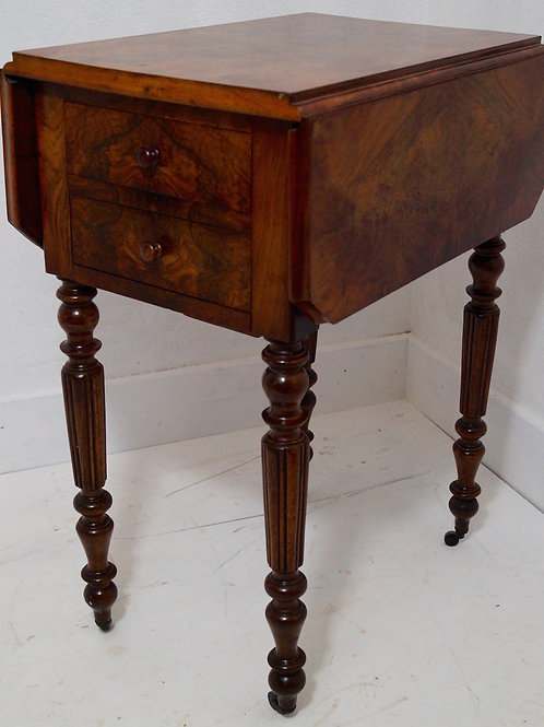 An Antique French Louis Philippe Walnut Drop Leaf Table