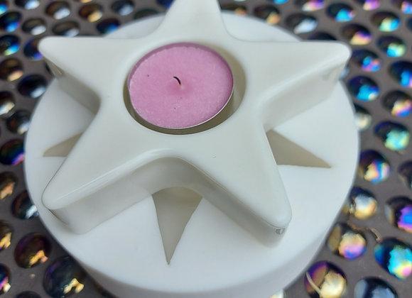 Star tealight holder.